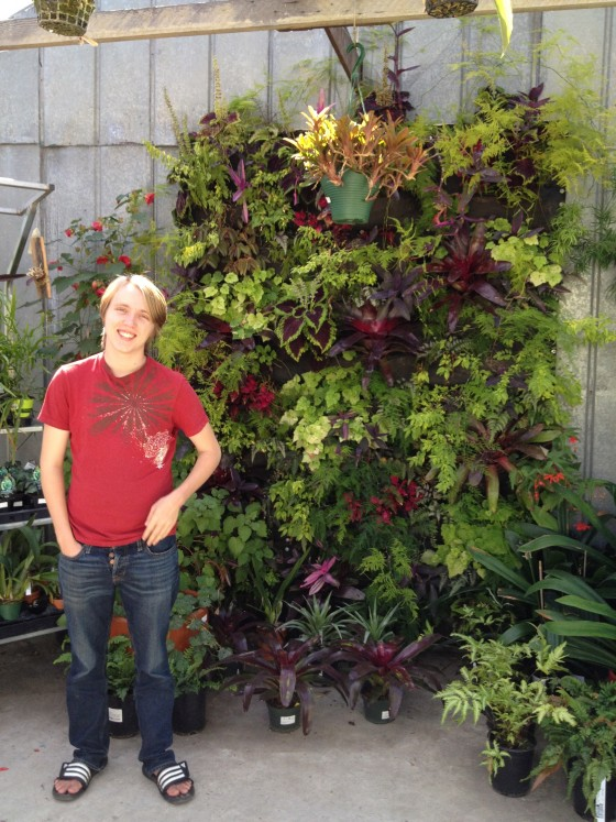 Elliot in front of the vertical garden